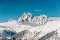 Bello paesaggio di inverno dei pendii di alta montagna Immagine Stock Libera da Diritti
