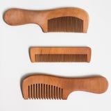 Bello pettine di legno semplice tre Fotografia Stock Libera da Diritti