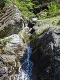 Bello piccolo fiume vicino al oeschinensee nel kandersteg Fotografia Stock Libera da Diritti