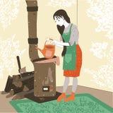 Bello, ragazza che fa caffè sulla stufa nel villaggio Fotografia Stock Libera da Diritti