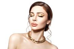 Bello ritratto di una ragazza con oro. Immagini Stock