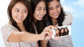 Bello selfie asiatico di festa delle ragazze Immagini Stock