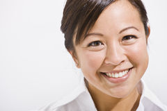 Bello sorridere asiatico della donna immagini stock libere da diritti