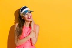Bello sorriso e vestito rosa Immagine Stock