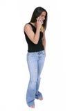 Bello teenager con il cellulare sopra bianco immagine stock