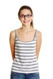 Bello teenager femminile con i vetri sul suo fronte. Fotografia Stock Libera da Diritti