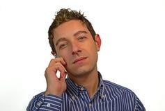 Bello tirante che comunica sul telefono delle cellule fotografia stock libera da diritti