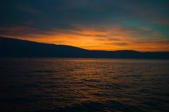 Bello tramonto sulla polizia italiana del lago Fotografia Stock