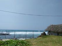 Bello villaggio del lato della spiaggia della foto naturale fotografie stock