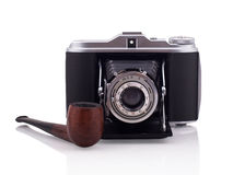 Bellows camera and smoking pipe Royalty Free Stock Image