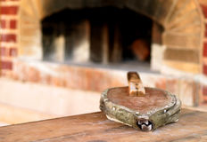 Bellows and Hearth. Old bellows with out of focus brick hearth in background Stock Photo