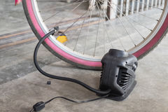 Bellows tire inflate to bicycle Stock Photos
