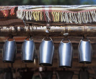 Bells. Five metal bells on wood shaft stock photography