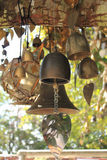 Bells. Ancient Thai bells on the tree in temple Stock Image