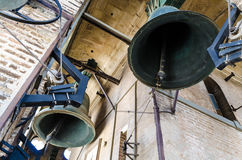Bells of the ancient tower Giralda, Cathedral, Seville, Spain. Two bells in motion, view from below, tower Giralda. Cathedral of Seville, Andalusia, Spain Stock Photo