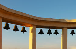 Bells. Arch with bells on blue sky background Royalty Free Stock Images