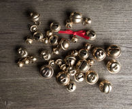 Bells and bow on wood Royalty Free Stock Photo