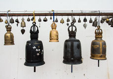 Bells in a Buddhist Thai temple Stock Photo