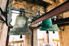 The bells in the chapel. Vintage old large bells in the bell tow Royalty Free Stock Images