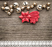 Bells, christmas decorations of wax, star on wood Royalty Free Stock Photos