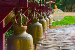 Bells. The column of bells with bamboo pathway Royalty Free Stock Photography