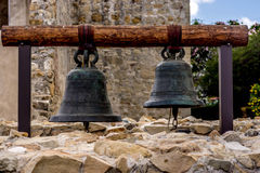 Bells from the courtyard of a California Mission. The bells from a courtyard in a California Mission with early morning soft light Stock Photography