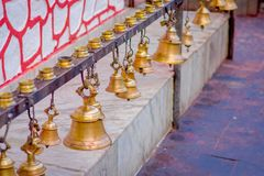 Bells of different size hanging in Taal Barahi Mandir temple, Pokhara, Nepal.  royalty free stock photography