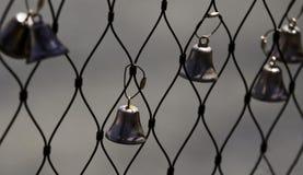 Bells fixées à une barrière de bord de mer Images stock