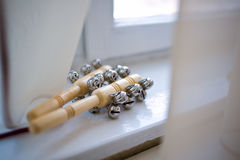 Bells on the handle. Bell on the handle lie on the windowsill during the children's festival Royalty Free Stock Photography