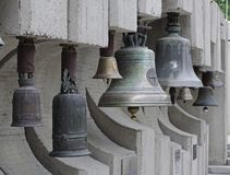 Bells hanging on the sidewalk stock photography