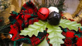 Christmas decorations. Bells and leaves Christmas decorations, red ribbon, ornaments Royalty Free Stock Image