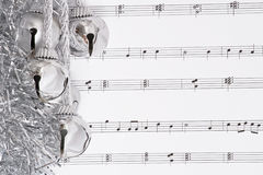 Bells and music. Silver bells and chrstmas music Stock Photos