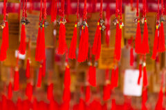 Bells with red thread Stock Images