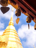 Bells at roof of pavillion in Chiangmai. Bells at roof of pavillion around golden pagoda in Wat Phra That Doi Suthep under cloudy sky in Chiangmai, Thailand stock photography