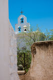 The Bells of San Xavier. Del Bac mission contrast with blue sky and whitewashed architecture Royalty Free Stock Image
