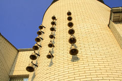 Bells on side of a building Royalty Free Stock Photography