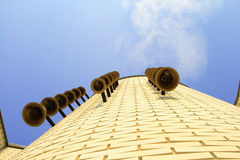 Bells on the side of building. Looking up on bells on the side of a building and blue sky Stock Photo