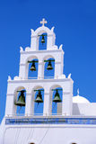 Greek Orthodox church bells. Typical church architecture and bells on Greek Orthodox Church at Oia on the Island of Santorini with blue sky background Royalty Free Stock Photography