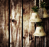 Bells on wooden wall. Christmas bells on a wooden background Stock Photo