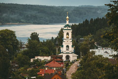 Belltower on the bank of the Volga River. Belfry in a small town on the banks of the great Russian Volga River Stock Images