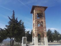 Belltower, bellfry at Gracanica monastery, Bosnia and Jerzegovina. Blue sky in background royalty free stock images