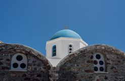 Belltower and bells on Greek Orthodox church in Oia stock photos
