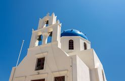 Belltower and bells on Greek Orthodox church in Oia royalty free stock photo