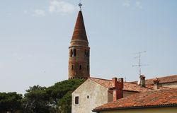 Belltower in Caorle with Foreground Buildings Royalty Free Stock Photos