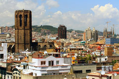 Belltower of cathedral, house and roof. Barcelona, Spain. Barcelona is the capital city of the autonomous community of Catalonia in Spain and Spain's second most Royalty Free Stock Images