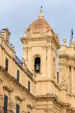 Belltower of the Cathedral of Noto. Closeup of the belltower of the historic baroque cathedral called Basilica Minore di San Nicolo in Noto, Sicily, Italy royalty free stock photos