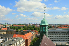 Belltower of church and city roofs. Copenhagen, Denmark Royalty Free Stock Photography