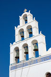 Belltower of a church in Oia Stock Images