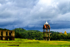 Belltower and cloud rains Stock Photos