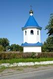 Belltower der Kirche zu Ehren einer Ikone der Mutter von Gott ` Zeichen ` Znamensk, Kaliningrad-Region Lizenzfreie Stockbilder